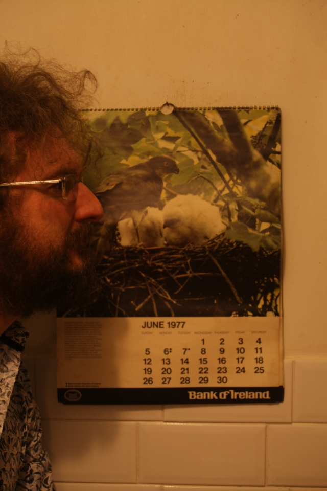 Jonathan Millar comparing his beak to that of the bird of prey featured on the calendar for the month of June (Digital Photograph: Leigh Millar, April 2005)